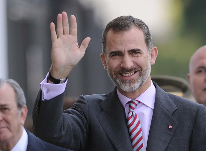 Spanish King Felipe VI waves on arrival before attending the Real Mae