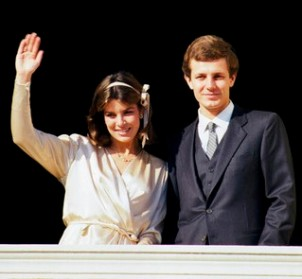 29 Dec 1983, Monaco --- Princess Caroline of Monaco waves to admirers as she stands on a balcony with her new husband Stefano Casiraghi at the Royal couple's wedding. --- Image by © CORBIS SYGMA