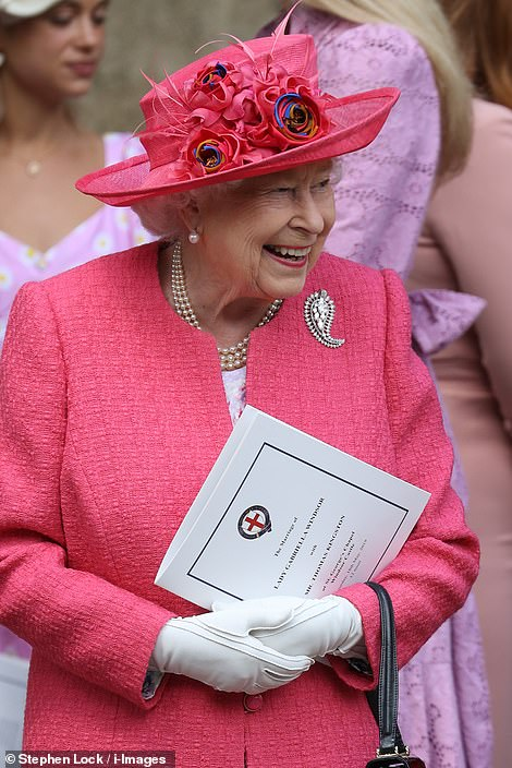13655822-7043855-The_Queen_looked_overjoyed_as_she_beamed_outside_St_George_s_cha-m-297_1558184654773